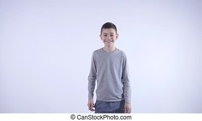 boy in dark clothes dancing on a light background