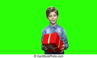 Boy in denim jacket with red gift box.
