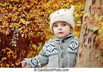 boy in fall forest