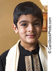 Portrait of an Indian boy in traditional formal attire.