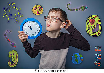 boy in glasses holding a clock