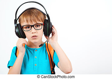 Boy in glasses wearing headset with microphone, isolated on white. Remote education.