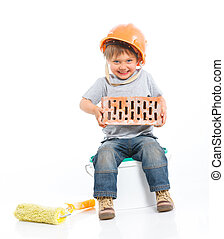Boy in hard hat with brick