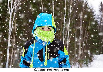 Boy in heavy snow fall