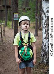 Boy in helmet and travel gear