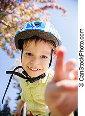 Boy in helmet looking at camera