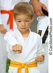 boy in karate suit training