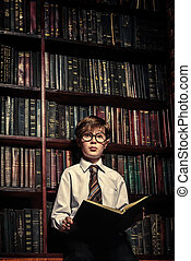 boy in old library