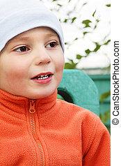 Boy in orange closeup