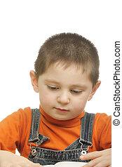 Boy in orange reading book