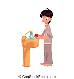 Boy in pajamas washing hands with soap under running water