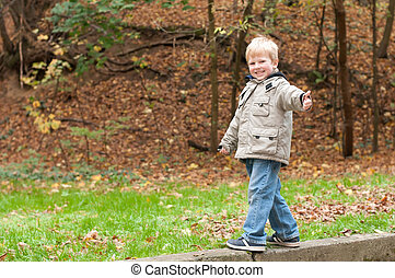 Boy in park with super sign