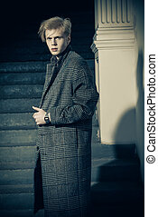 boy in plaid coat