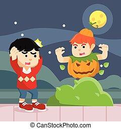 boy in pumpkin costume suprising