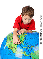 boy in red shirt leans on inflatable globe isolated on white background