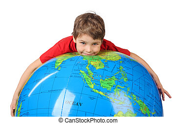 boy in red shirt lies on inflatable globe isolated on white background