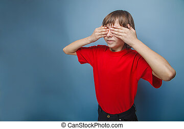 boy in red t-shirt teenager brown hair European appearance eyes