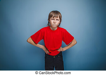 boy in red t-shirt teenager brown hair European appearance with