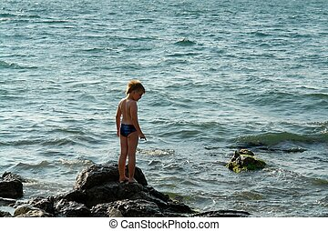 boy in sea waves