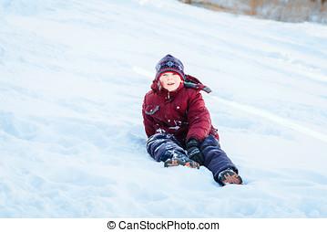 boy in snow - 9-year-old boy sitting on snow
