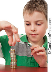 boy in striped T-shirt  stacking up coins  isolated on white background