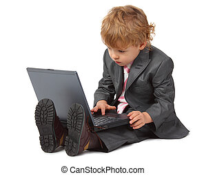 Boy in suit with laptop