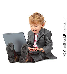 Boy in suit with notebook