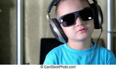 Boy in sunglasses listening to music on headphones