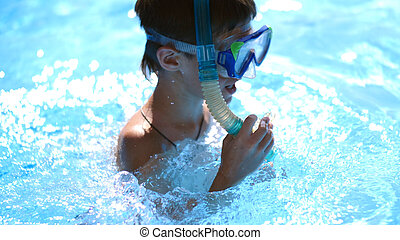 boy in swimming mask in the pool