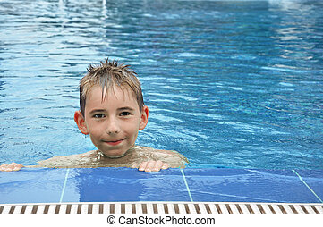 boy in swimming pool - 9 year old kid in a swimming pool...