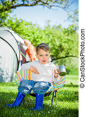Boy in the camping great outdoors - Cute little boy resting ...