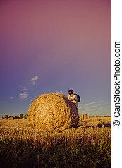 boy in the field on hay