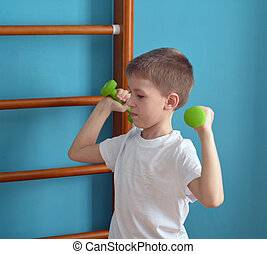 boy in the gym with grips