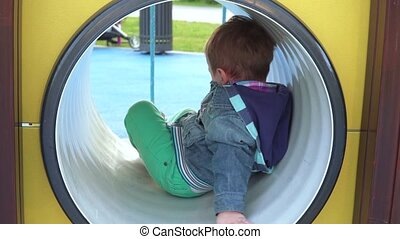 Boy in the pipe at the playground