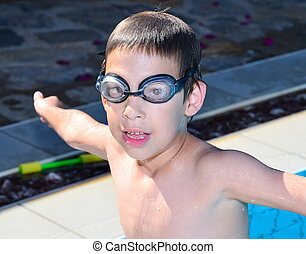 Boy in the Pool - A 6-year-old boy having fun in the...