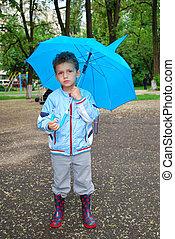 boy in the rain.