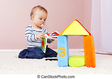 Boy in the room, playing happily. - Construction of the...