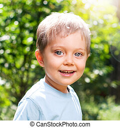 Boy in the summer park - Cute 2 years old boy outdoors at...