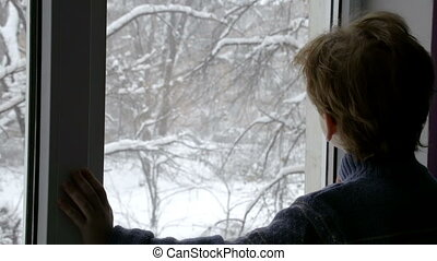 Boy in the Winter Window
