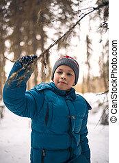 boy in the winter woods