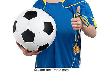 Boy in ukrainian national soccer uniform