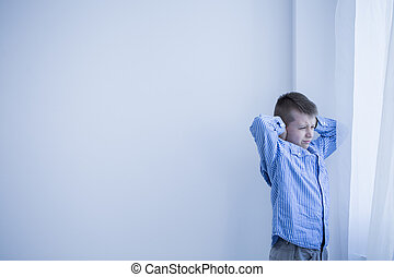 Boy in white room