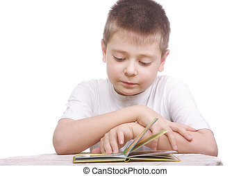 Boy in white shirt reading book