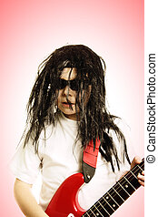 Boy in wig with red guitar