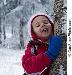 Boy in winter forest