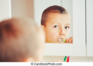 Boy is cleaning teeth - Everyday life at home. Little boy is...