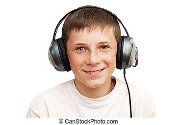 boy is listening to music on headphones