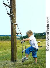 Boy is making a climb