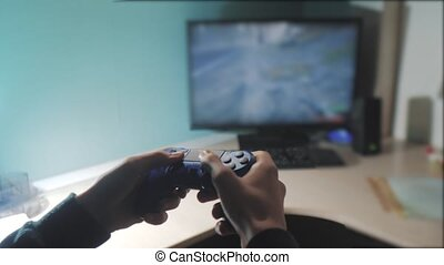 boy is playing on controller joystick gamepad the console ...