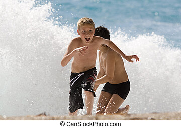 running - boy is running away from the waves